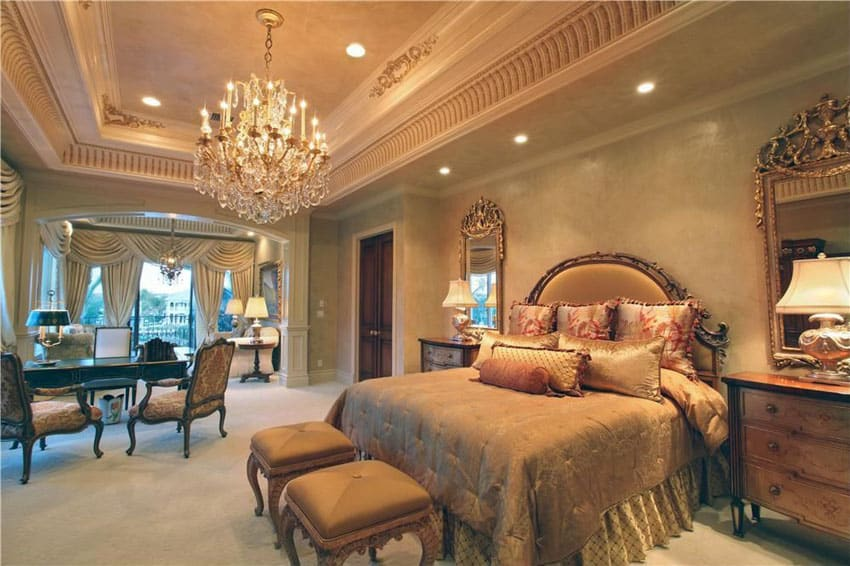 High end master bedroom with elegant bed furniture and chandelier in french gold