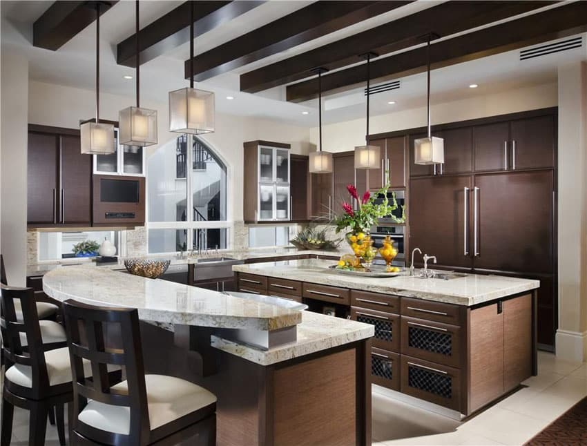 Kitchen with dark high gloss foil cabinets, breakfast bar island, mini pendant lights and bianco romano granite counters