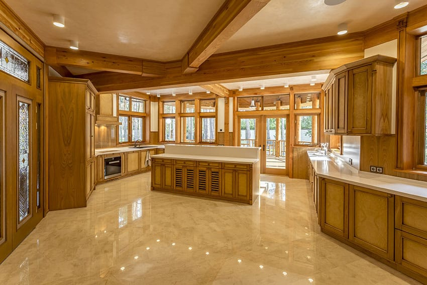 Large wood kitchen with expansive window views and large beams