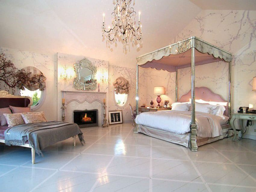 Luxury bedroom with four poster bed, pink color theme chandelier and day bed