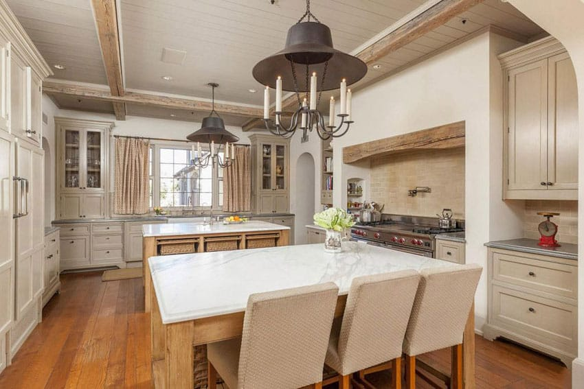 Luxury country kitchen with calacatta classic marble counter islands, exposed beams, hickory hardwood floors and subzero and wolf range