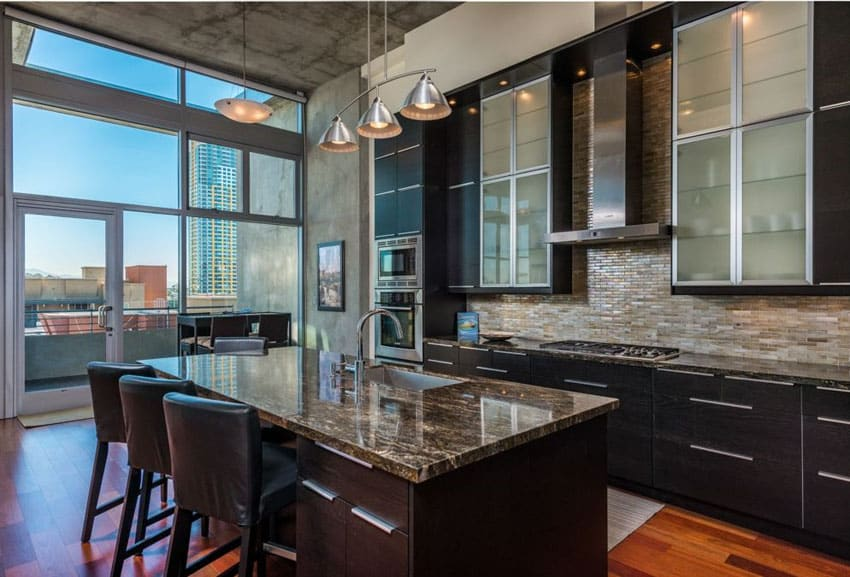 Modern dark cabinet kitchen with frosted glass doors granite counter island and maple wood flooring