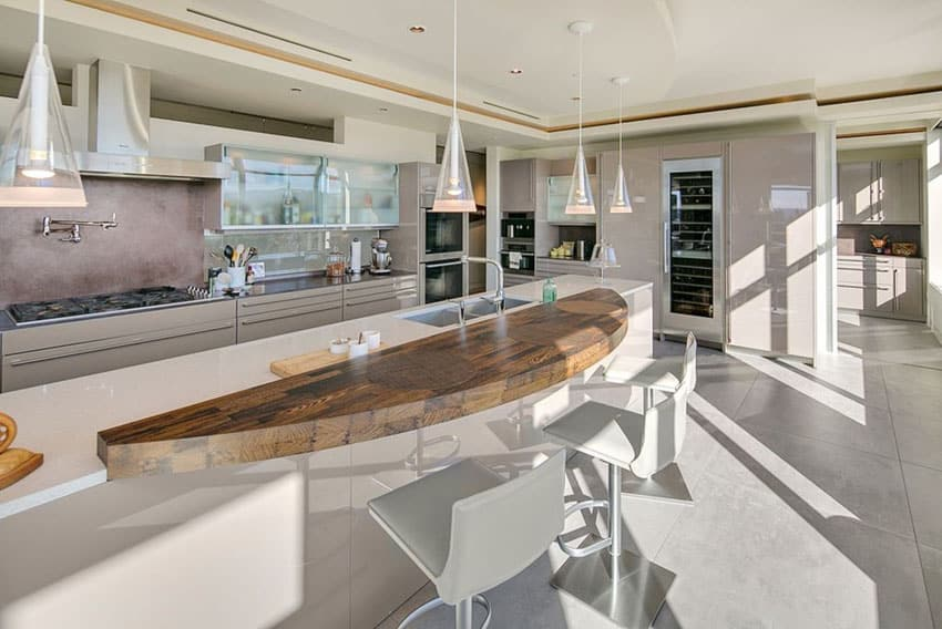 Modern kitchen with rustic wood curved counter island with white high gloss cabinet