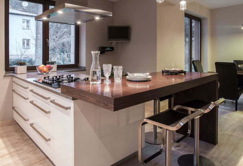 Modern kitchen with solid wood surface countertop and chrome no back bar stools