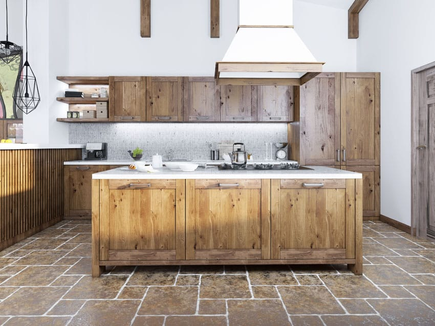 Reclaimed wood kitchen with large island and open beam ceiling