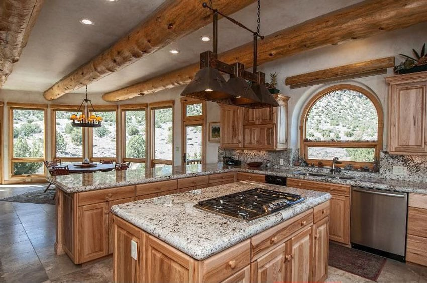 Rustic kitchen with andino white granite countertops, wood cabinets and porcelain tile floors