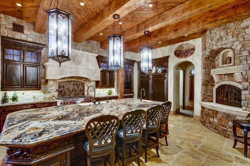 Rustic kitchen with azurite granite island and six light pendant lighting