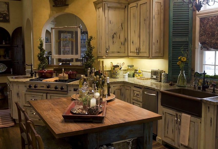 Rustic kitchen with copper farmhouse sink and distressed cabinetry