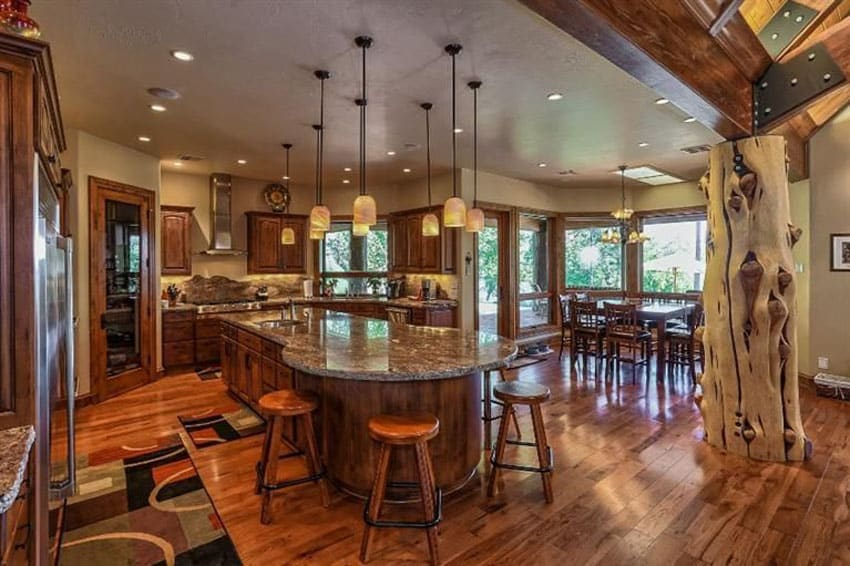 Traditional kitchen with large decorative tree centerpiece custom island and maple hardwood floors