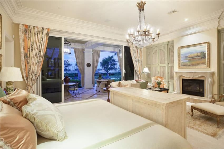 Traditional master bedroom with empire basket chandelier and cream decor