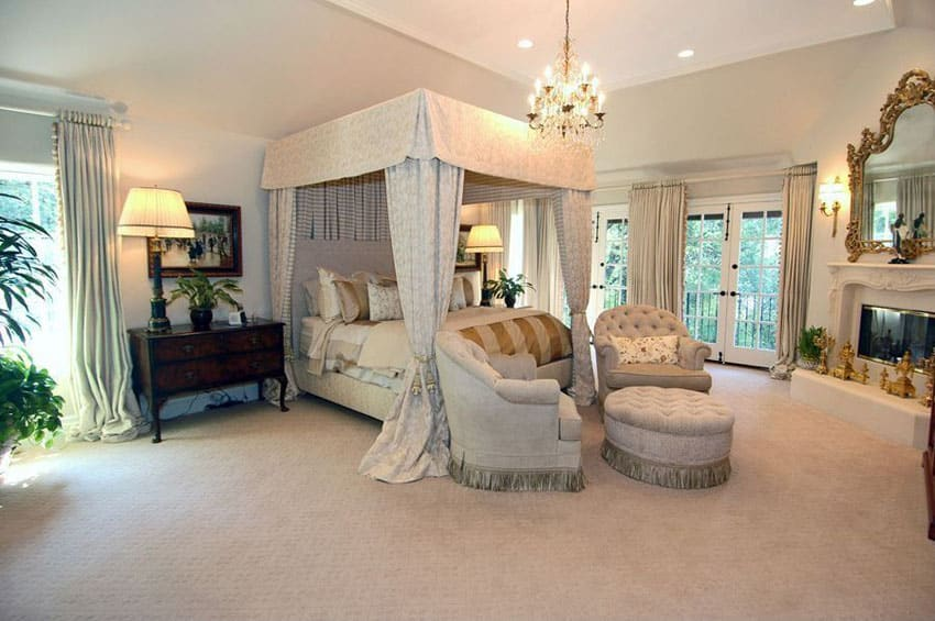 Traditional master bedroom with french doors and four poster bed