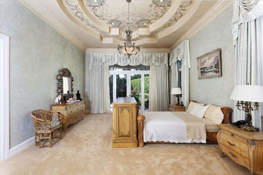 Traditional master bedroom with vintage furniture pieces and raised tray ceiling