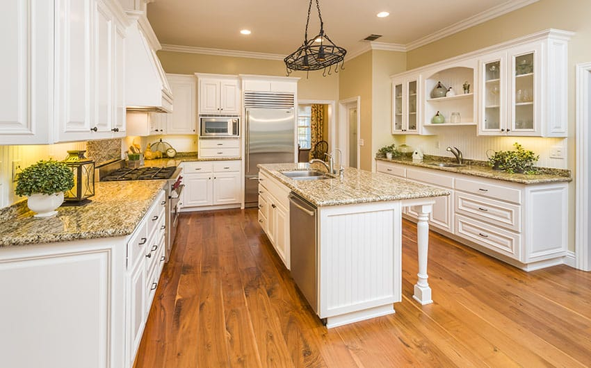 Modern farmhouse kitchen with white cabinets, yellow granite counters ...