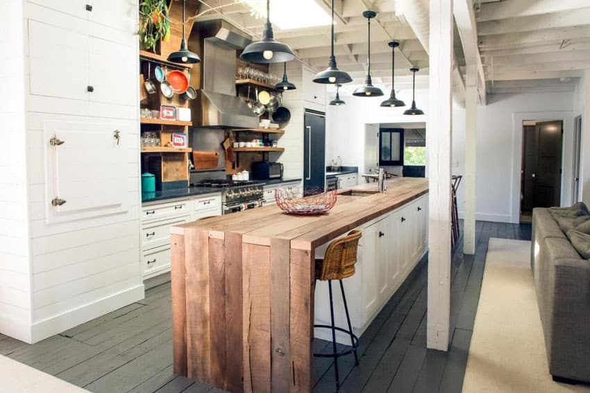 White kitchen with inset cabinets and wood plank island