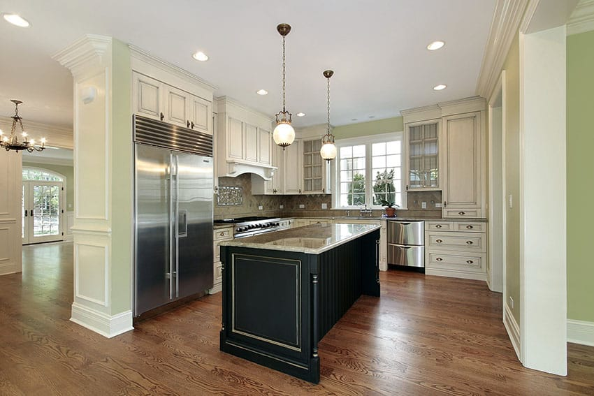 Antique wood kitchen cabinets with black island