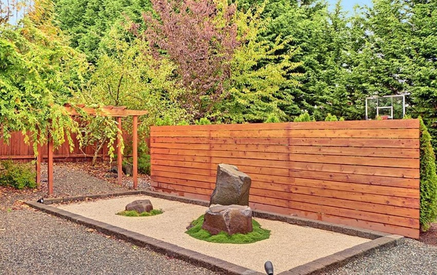 Asian landscaping with custom horizontal privacy fence