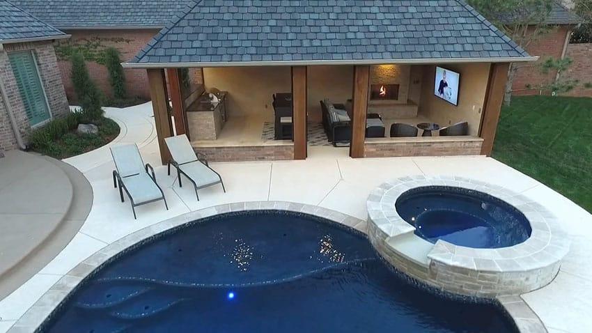 Backyard cabana with kitchen fireplace tv net to pool spa