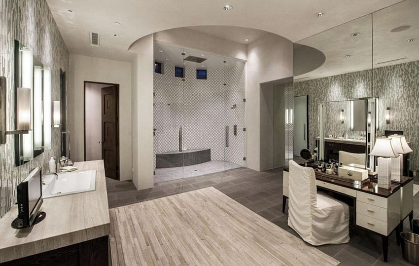 Beautiful luxury master bathroom with granite counter vanities and makeup counter