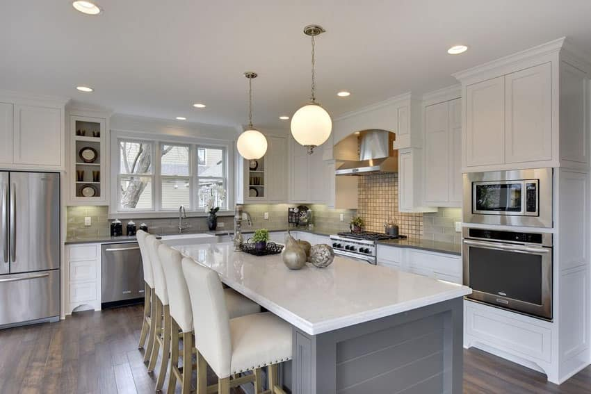 Beautiful kitchen with gray cabinet breakfast bar island and white cabinets