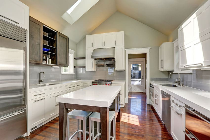 Beautiful u shaped kitchen with white cabinets white countertops and wood island