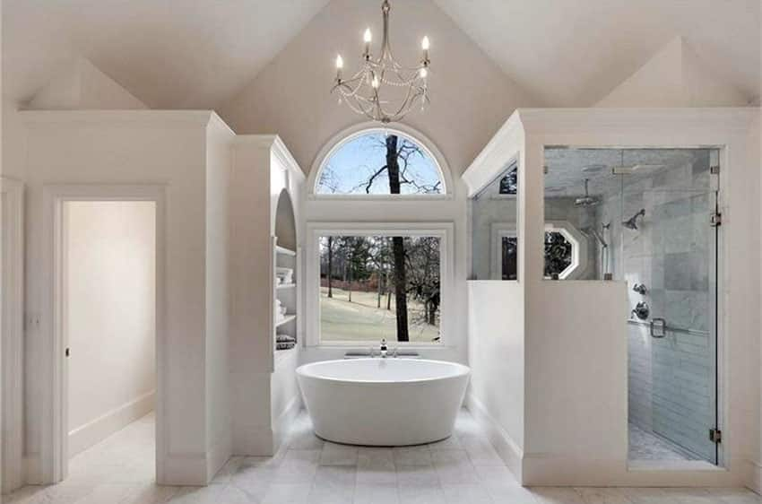 Beautiful white marble modern bathroom with chandelier and high ceilings