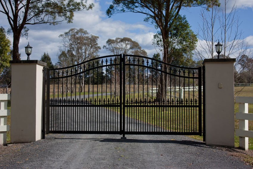 Black wrought iron gate at driveway