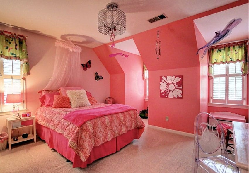 Bright cheerful pink girls bedroom with princess canopy