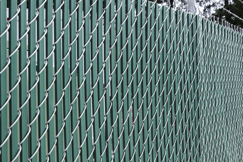 Chain link fence with privacy slats