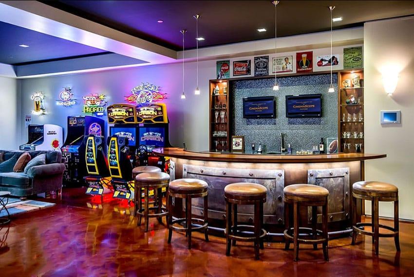 Circular man cave home bar with arcade games