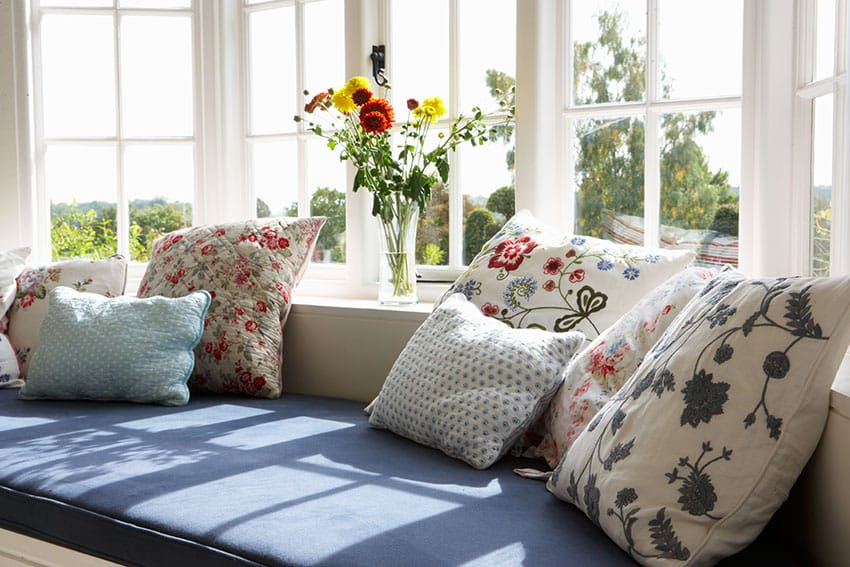 Colorful cushions in bay window