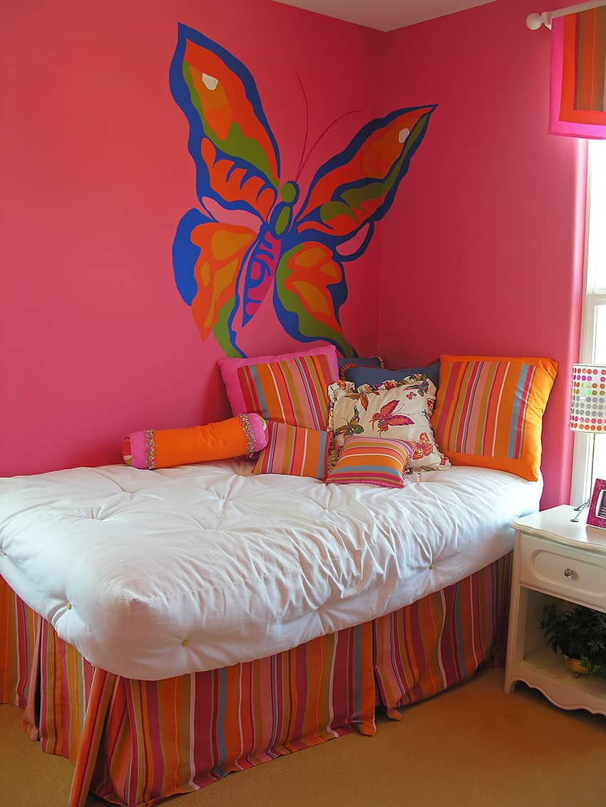 Colorful girls room with large butterfly wall mural