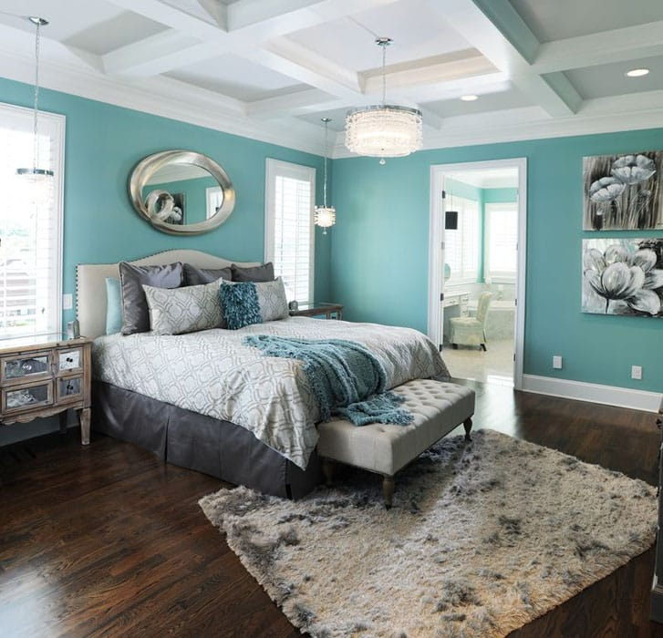 Contemporary bedroom teal walls, mirror dressers, wood flooring and shag drum pendant lights