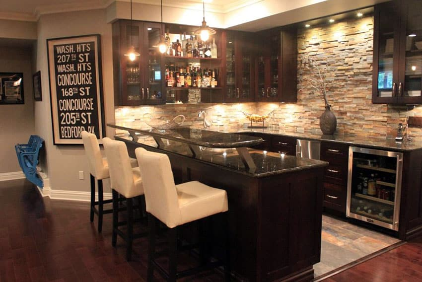Contemporary home wet bar with dark cabinets and fridge