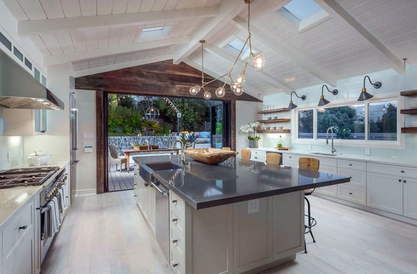 Contemporary kitchen with stainless steel island and vaulted ceiling