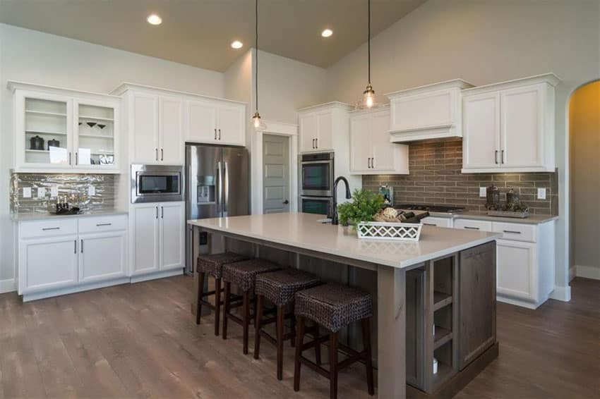 Cottage kitchen with dark island and white cabinets