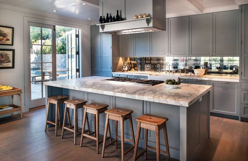 Cottage kitchen with gray cabinets white calacatta marble and wide plank wood floors