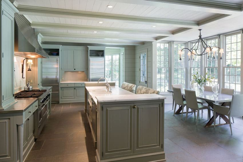 Cottage kitchen with green cabinets Calacatta marble counter and breakfast bar island