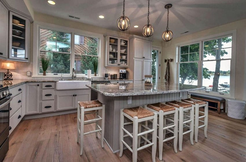 Cottage kitchen with island, wood flooring, and farmhouse sink