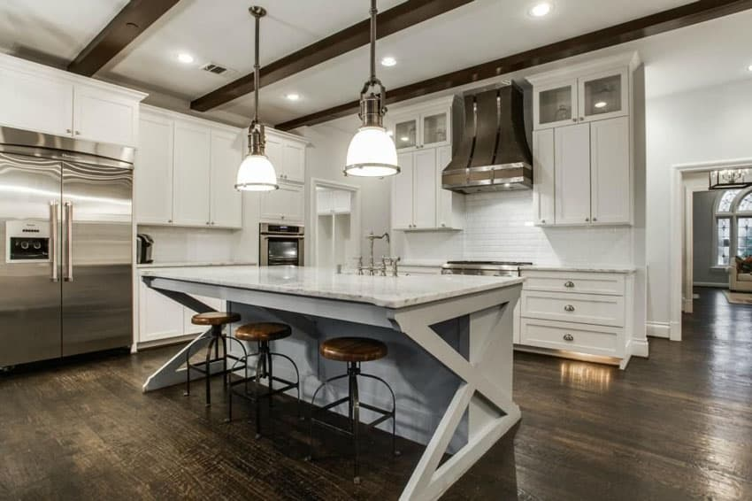 Cottage kitchen with white cabinets, breakfast bar island and carrara marble counters