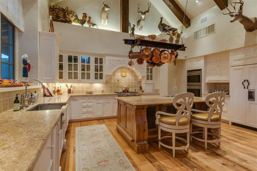 Country kitchen with vaulted ceiling, hickory wood floors and island with siena beige granite counters