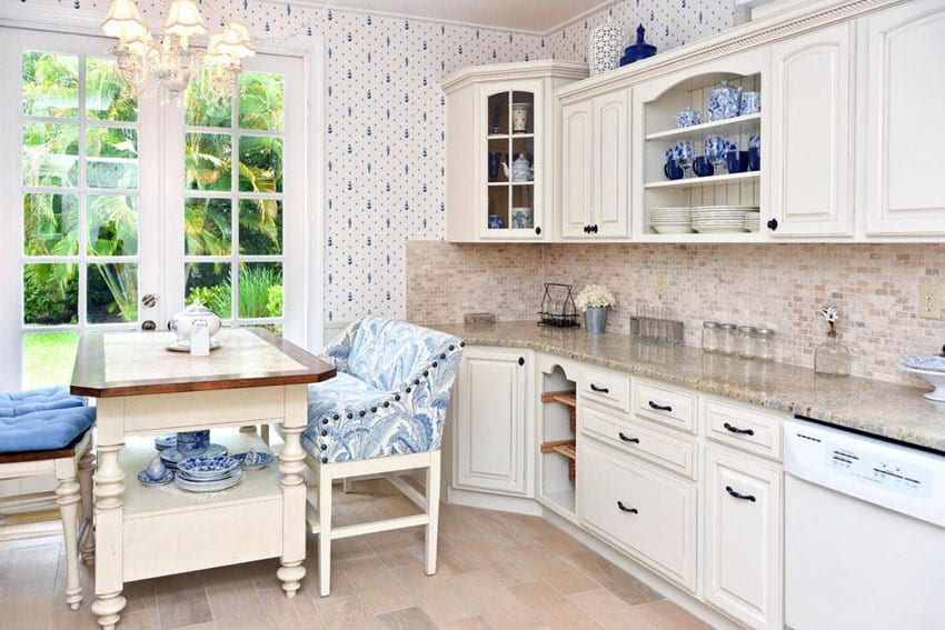Country kitchen with breakfast nook, white cabinets, appliances, cambridge white granite, and window seat dining table