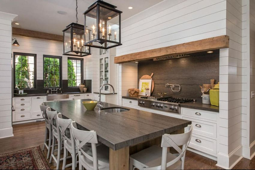 Country kitchen with white european style cabinets, travertine counter island and backsplash