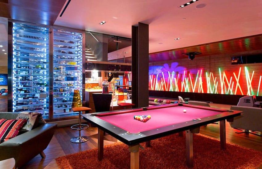 Custom man cave with neon lighting pool table and wine cellar