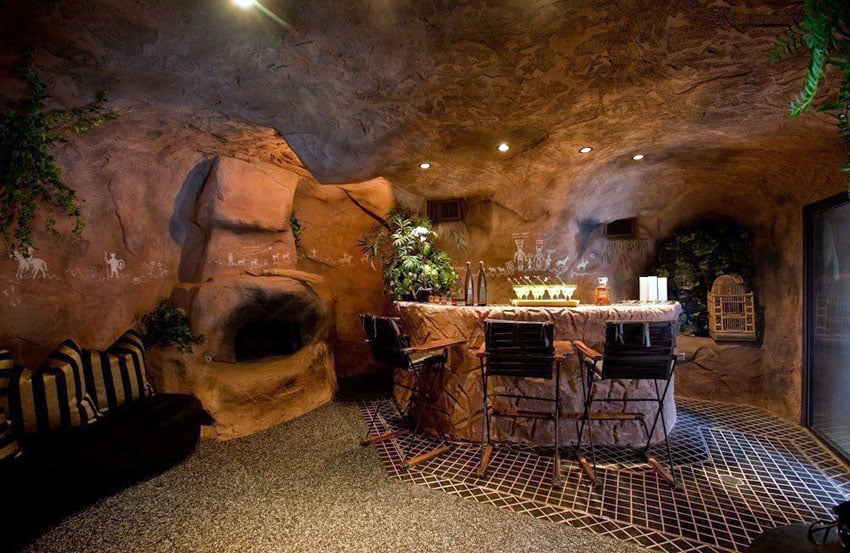 Custom man cave with rock walls and home bar