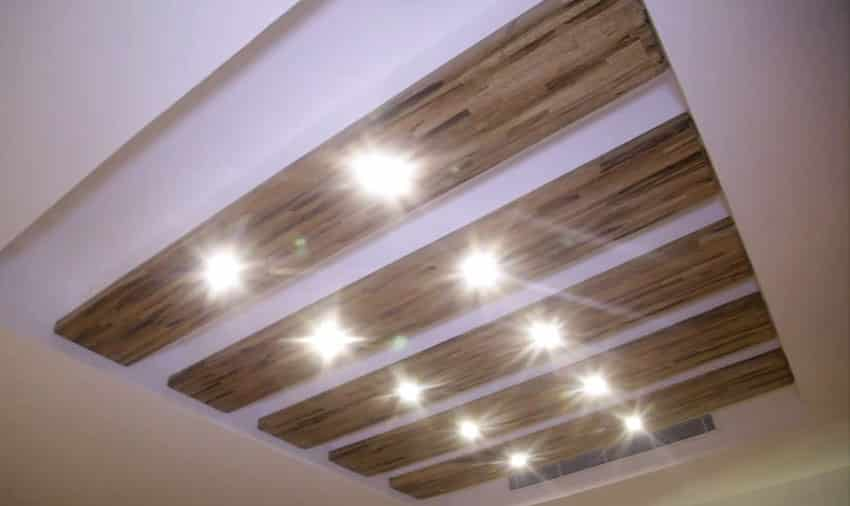 Custom recessed lighting with wood slats inside tray ceiling