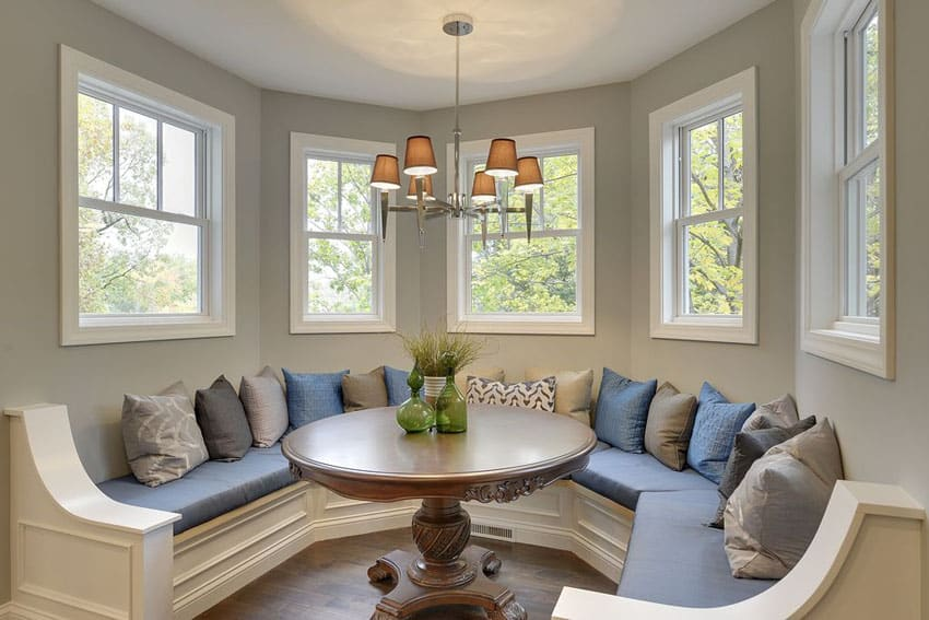 Custom window seat with throw pillows and blue cushions