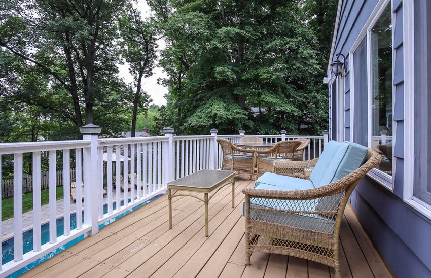 Deck fence with illuminated fence posts