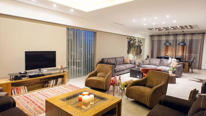 Decorated apartment living room in Africa with brown furniture