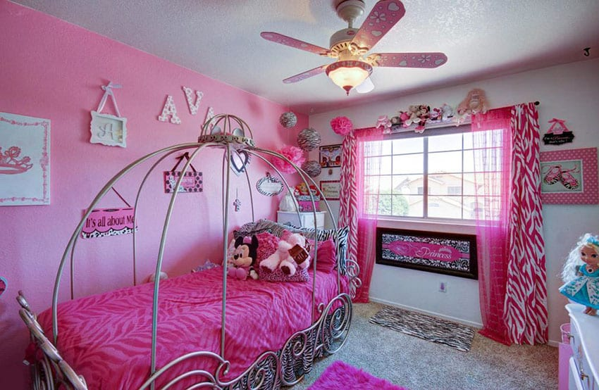 Disney princess girls bedroom in pink with canopy bed