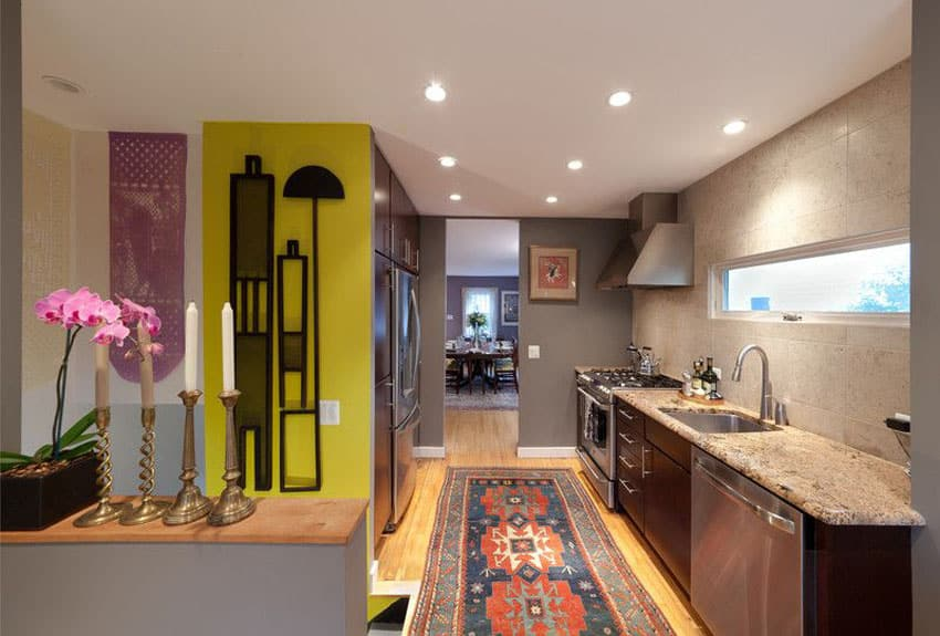 Eclectic galley kitchen with brown cabinets and yellow accent wall